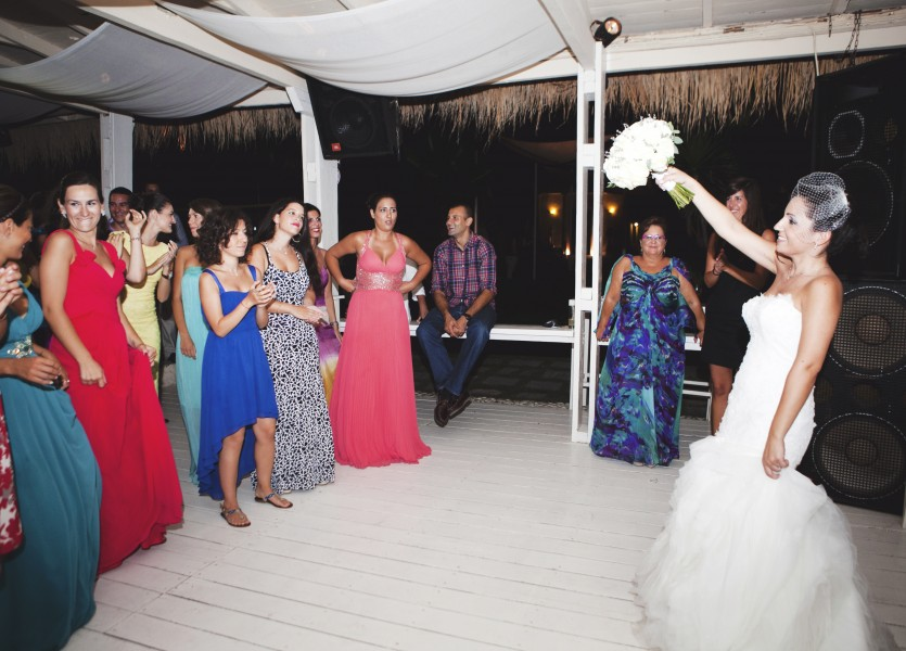 Throwing the Bridal Bouquet in Greek Wedding Party