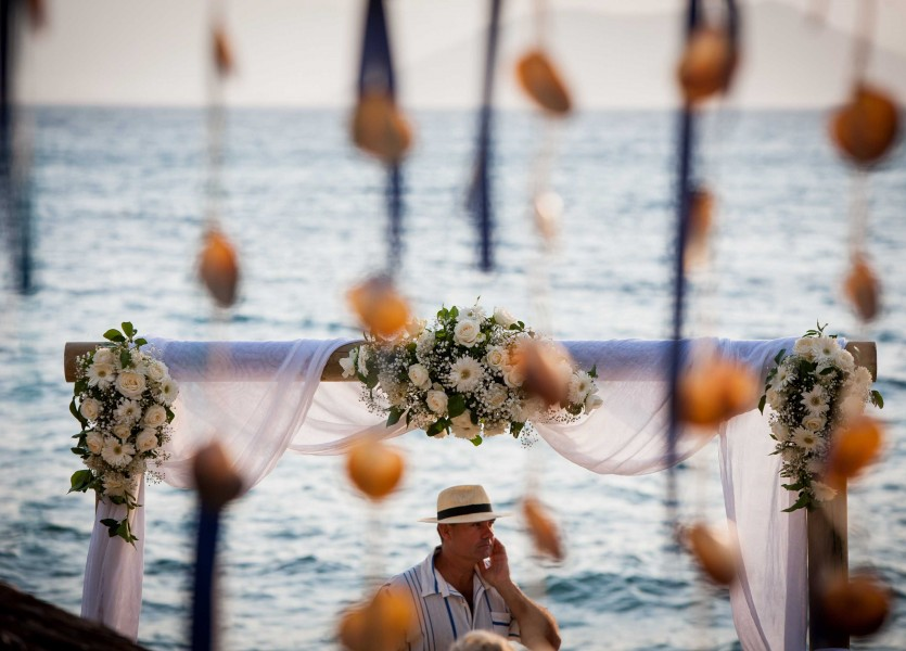 Beach Wedding Ceremony in Naxos with Wooden Flower Arch