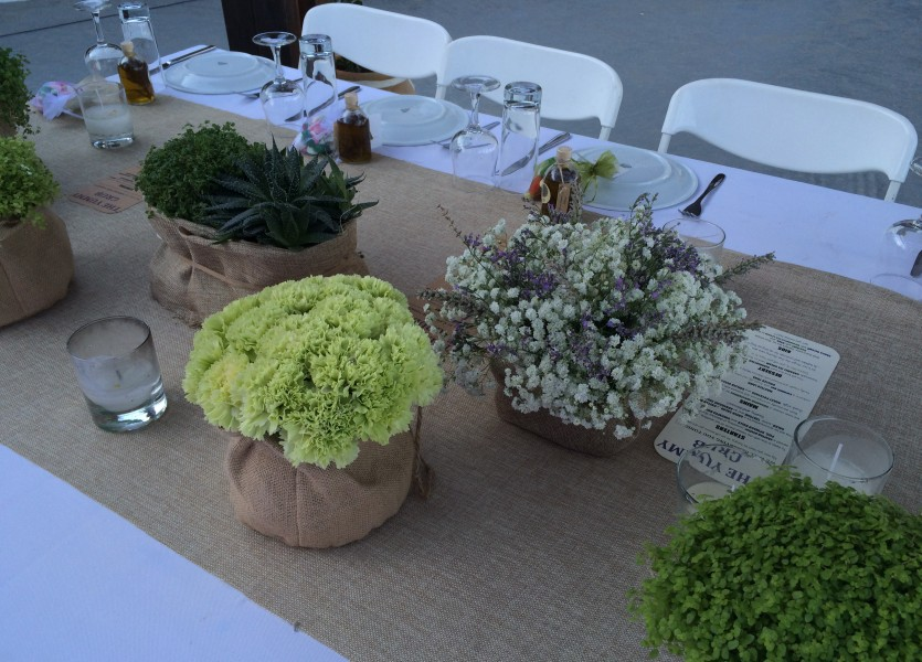 Burlap and wild flowers. Hydragea, babies breath.Rustic Wedding in Sifnos