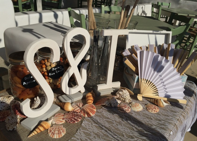 Seashells and white wooden initials