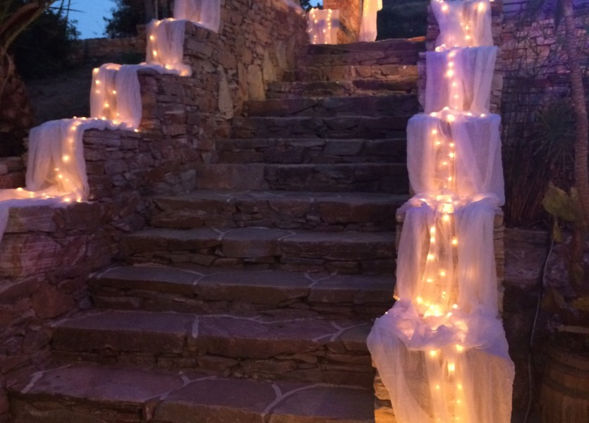 Walking down the aisle. Lovely decoration with led lights in Sifnos wedding.